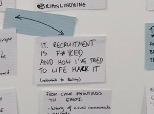 Index card on a wall, surrounded by others, it reads IT recruitment is f@!ked and how I tried to life hack it
